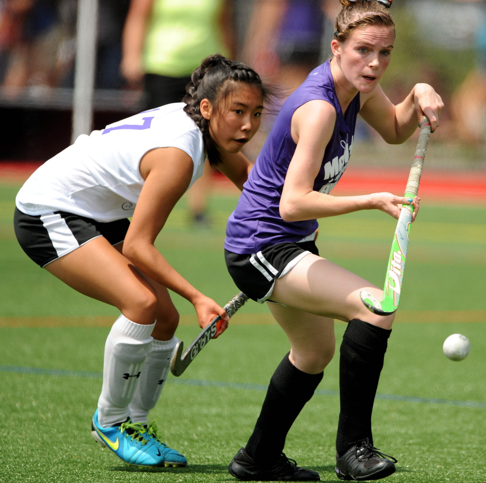 West senior All-Star Junyoung Shin, left, and East senior All-Star Braley Leadbetter battle for the ball in the McNally Senior All-Star Field Hockey Game on Saturday at Thomas College in Waterville. The East won 2-0.