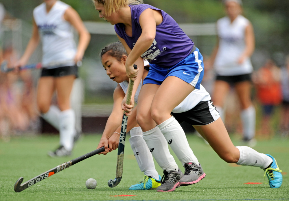 East Senior All Star  Madison Cummings, 10, front, battles for the ball with West Senior All Star Junyoung Shin, 17,  in the annual Senior All Star Game at Thomas College in Waterville on Saturday,.