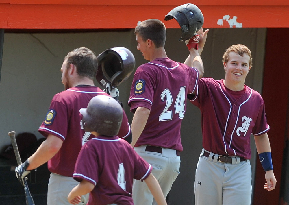Members of the Franklin County Flyers celebrate after scoring against Gardiner in the Senior Legion zone 2 baseball tournament at Memorial Field in Skowhegan on July 19. The Flyers won against Westbrook 4-1.