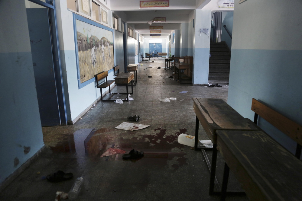 Blood and discarded belongings are seen in a corridor at a U.N. school in Beit Hanoun in the northern Gaza Strip on Thursday. Israel says its forces are not responsible for the deaths of the Palestinians who were sheltering in the school when it was shelled.