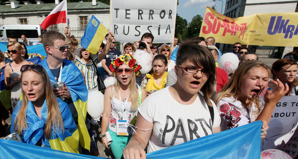 About 250 people protest against Russia's behavior  in the Ukraine conflict in Warsaw, Poland, on Sunday.