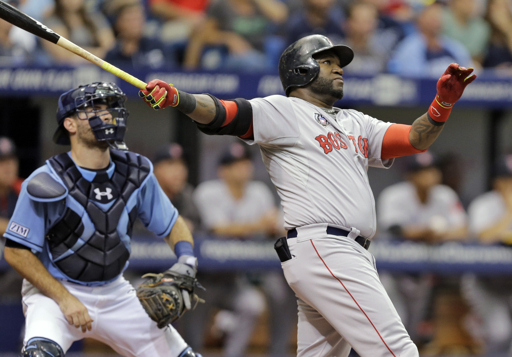 Boston's David Ortiz watches his three-run home run off Tampa Bay starting pitcher Chris Archer during the third inning Sunday in St. Petersburg, Fla. Boston's Daniel Nava and Dustin Pedroia also scored. Catching for the Rays is Curt Casali.