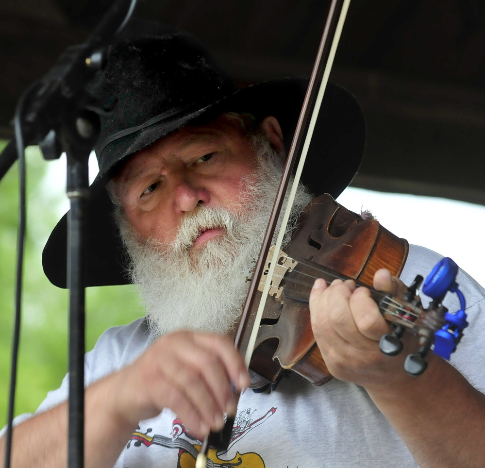 Fiddler Danny Thompson competes in the 42nd East Benton Fiddlers Convention on Sunday, July 27, 2014. After his performance the music was stopped as equipment was moved under cover before a hard rain fell.