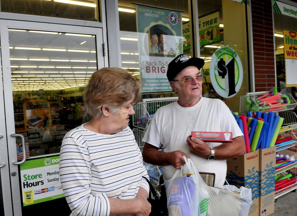 Linda and Dave Blanchard speak outside the Dollar Tree store in Waterville Monday about the planned merger of the store with the Family Dollar store.