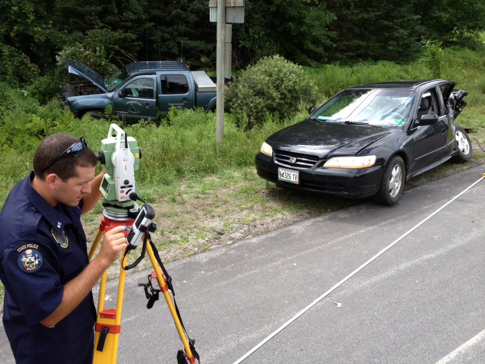 State Trooper Michael Pion reconstructs a two-car collision that claimed the life of man a couple minutes this morning in Vassalboro.