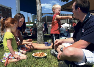 Liam Rose, 3, gives his dad Phil a French fry while enjoying the Taste of Greater Waterville last summer with his sister Isabelle and mother Heather. This years event, now named The Taste of Waterville, will be Wednesday, Aug. 6.