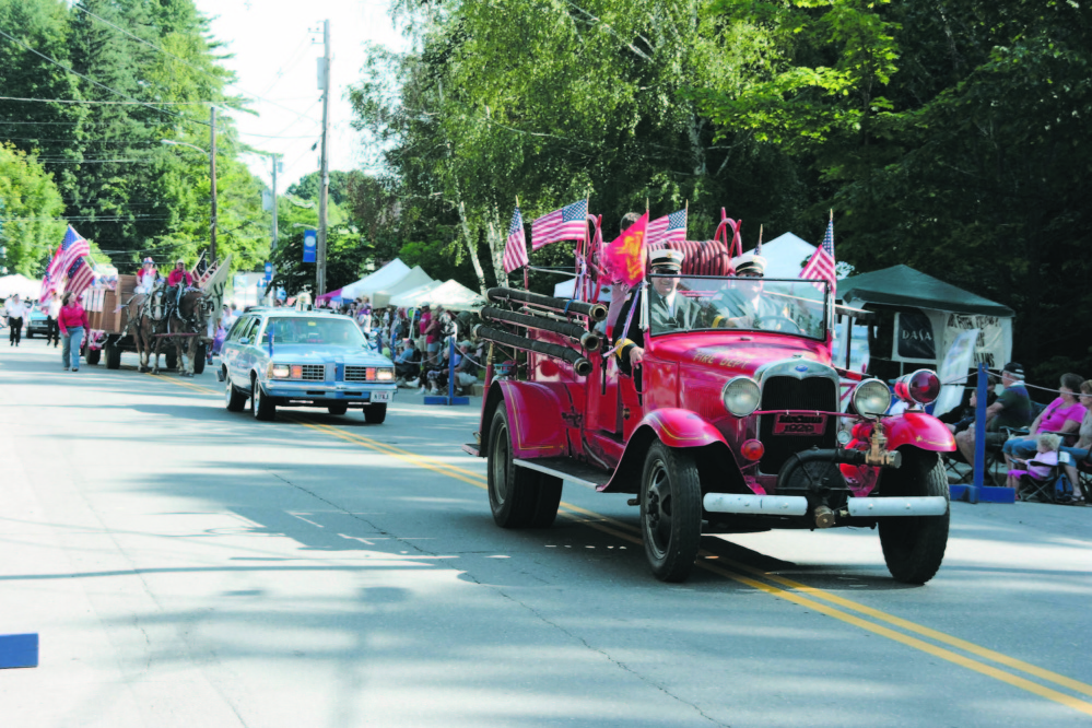 Fire officials lead the parade at a previous Wilton Blueberry Festival. The annual two-day event will be this Friday and Saturday.