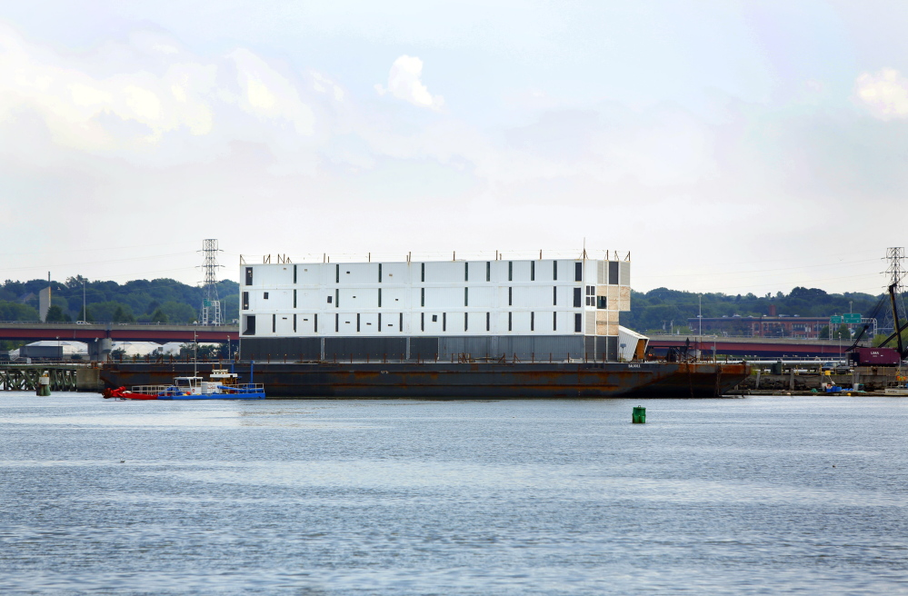 """Google's four-story barge sits in Portland Harbor. The barge was moved Wednesday to South Portland where it is being prepared for what was called """"an ocean voyage."""" Little to no construction has been done on the structure since it showed up in Maine last October."""