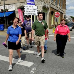 Democratic U.S. Senate candidate Shenna Bellows walks around downtown Waterville on Friday.