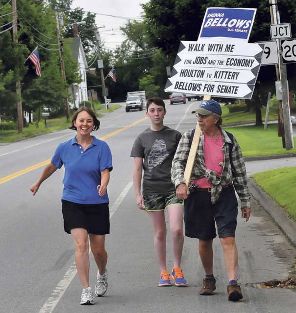 Democratic U.S. Senate candidate Shenna Bellows walks down U.S. Route 202 in Unity on Friday.