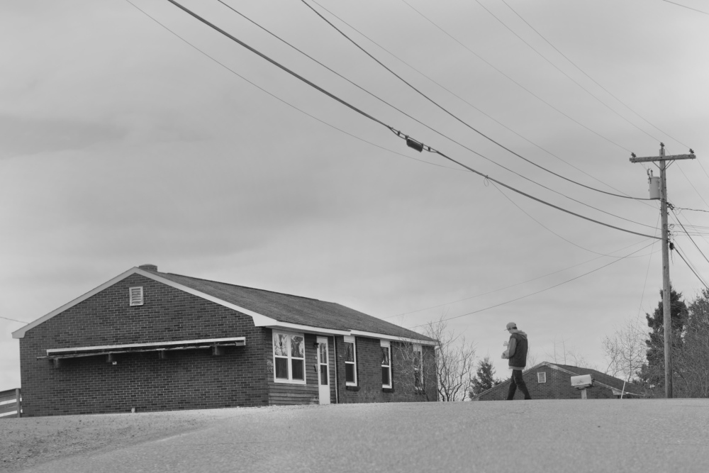 A man crosses Indian Road on the Passamaquoddy reservation at Pleasant Point this spring. In the 1960s, relations between law enforcement and the Indians living here had long been strained, both because of what sheriffs and state police would do and what they wouldn't.