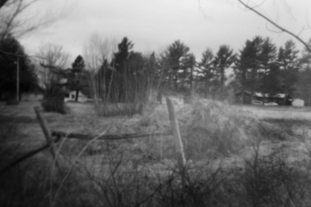 Just off Route 1 in Indian Township, this gravel pile, now a grass-covered mound, is where a group of Passamaquoddy sat in protest in 1964 to stop a white man from building a road on reservation land. The arrests that followed brought members of the tribe and Don Gellers together.