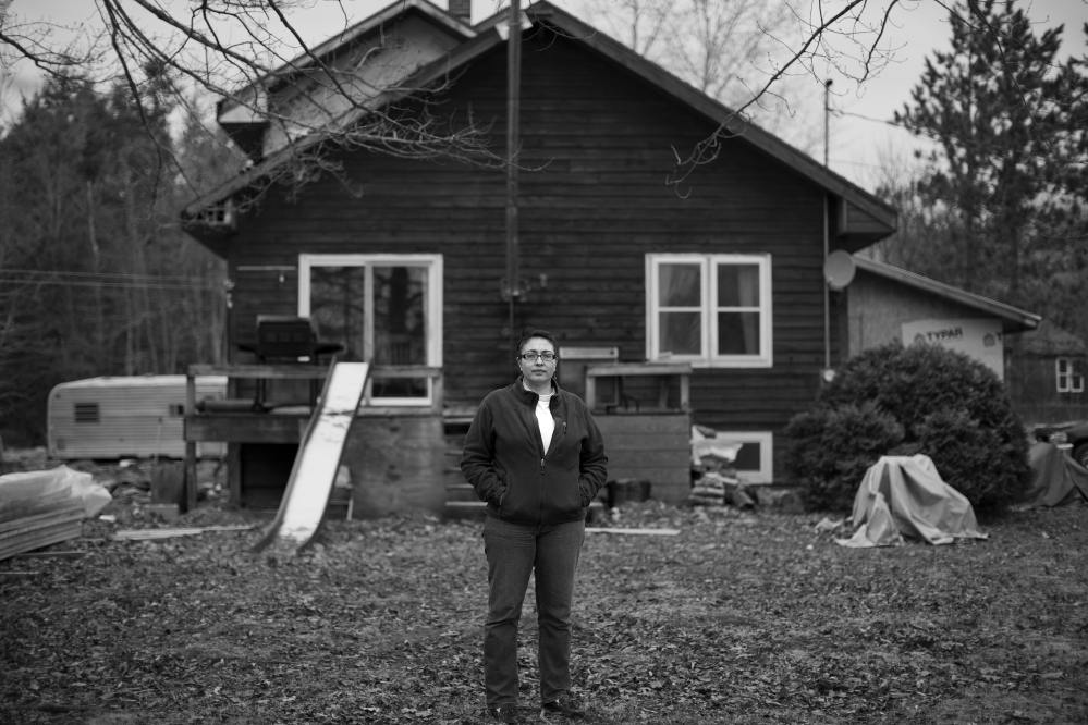 INDIAN TOWNSHIP, ME - APRIL 28: Stephanie Bailey stands for a portrait in the front yard of her Indian Township home Monday, April 28, 2014. A fearless advocate for her people, Bailey has run into roadblocks put up by tribal government when she tried to publish, first in print and then through email, a weekly newsletter informing the community of goings on in tribal government. (Photo by Gabe Souza/Staff Photographer)