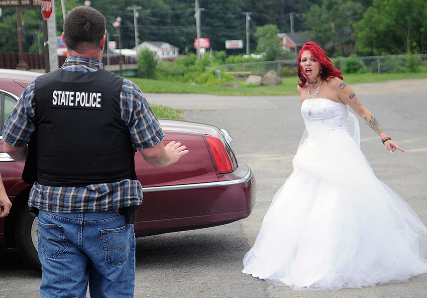 Theresa Rice-Goodrich screams Sunday July 27, 2014 at State Troopers in the parking lot of Fort Halifax Park in Winslow moments after Fred Horne Sr. was arrested for attending her wedding.  (Photo by Andy Molloy/Staff Photographer)