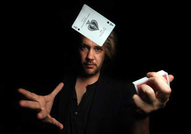 Bill VonTobel highlights a few of his up-close card tricks on Wednesday. VonTobel will be performing his Las Vegas act at the East Madison Grange this Friday and Saturday nights at 7:30.