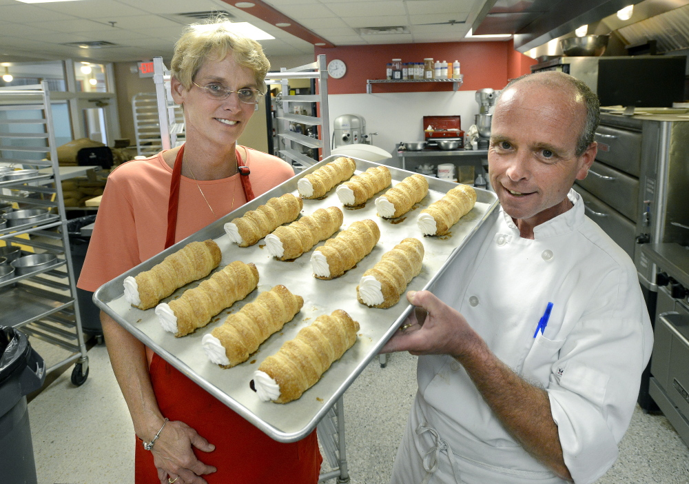 Molly and Ed Foley — and a tray of creme horns. Though they sold the business, the bakery will continue with the Foley name and assurances that the new owner will keep things as is.