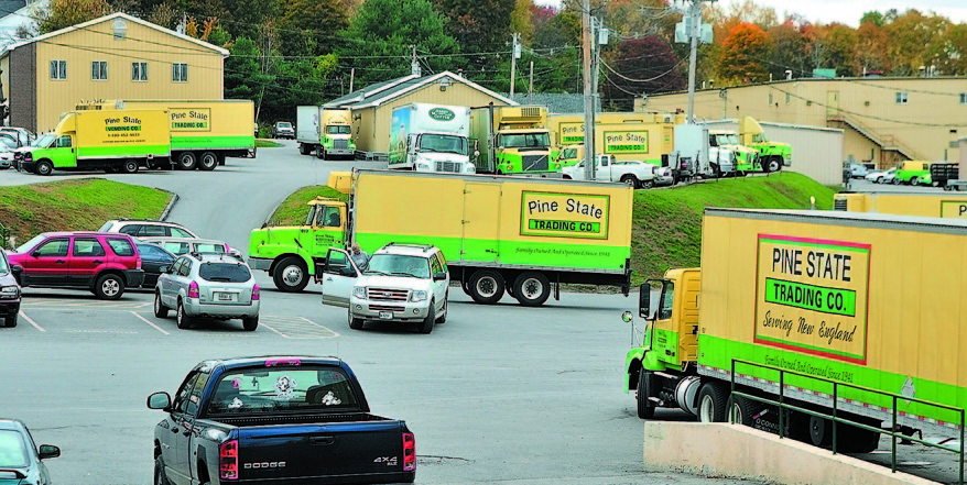 Trucks come and go at Pine State Trading Co. and the Maine Beverage Co. offices in Augusta. Pine State Trading Co. is the only firm to rebid for the state liquor marketing contract. A former challenger, Dirigo Spirit, did not submit a second bid.