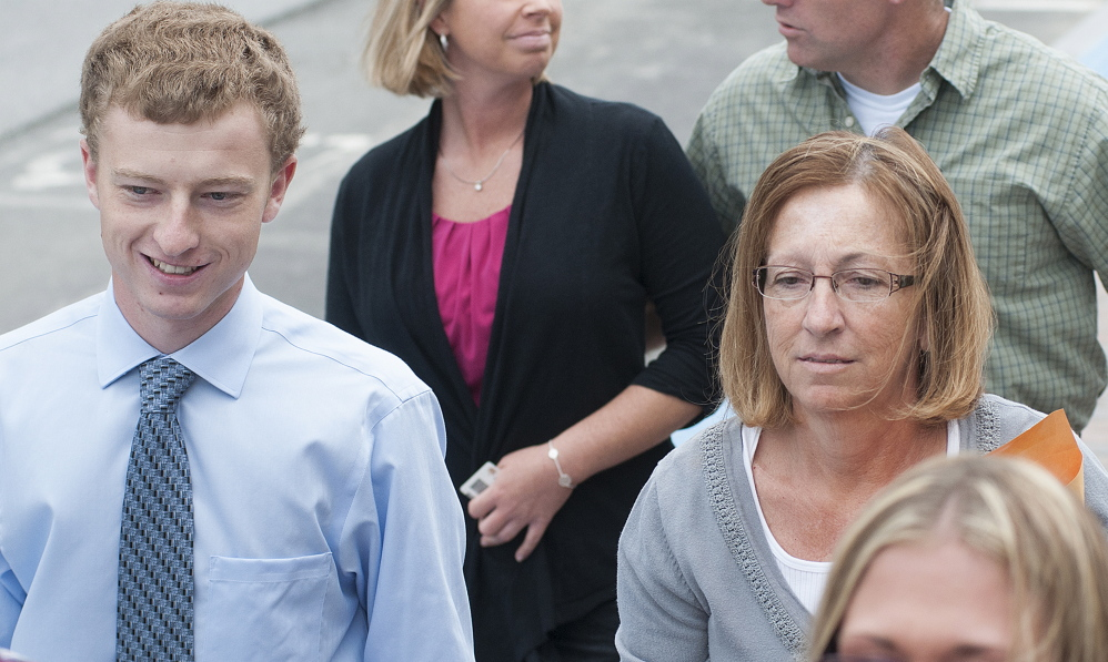 Carole J. Swan, former Chelsea selectwoman, with her younger son John Swan, as they enter the U.S. District Court building in Bangor for her sentencing hearing in June on extortion, tax fraud and workers compensation fraud.