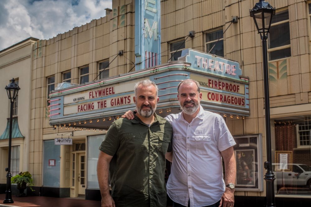 Stephen, left, and Alex Kendrick, pose outside The Gem Theater after shooting several car scenes along the main drag in downtown Kannapolis, N.C., for their fifth movie. The Kendrick brothers, who just wrapped up filming their fifth project, are making movies that could see wider release as distributors pay attention to the box office trends in the traditional Bible Belt and beyond.
