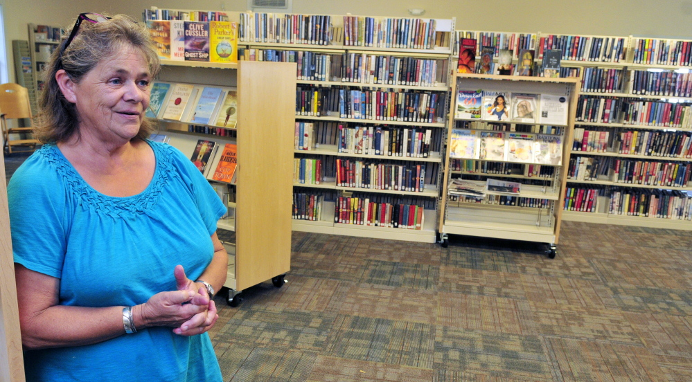 Librarian Donna McClusky leads a tour of new Umberhine Public Library on Thursday in Richmond.