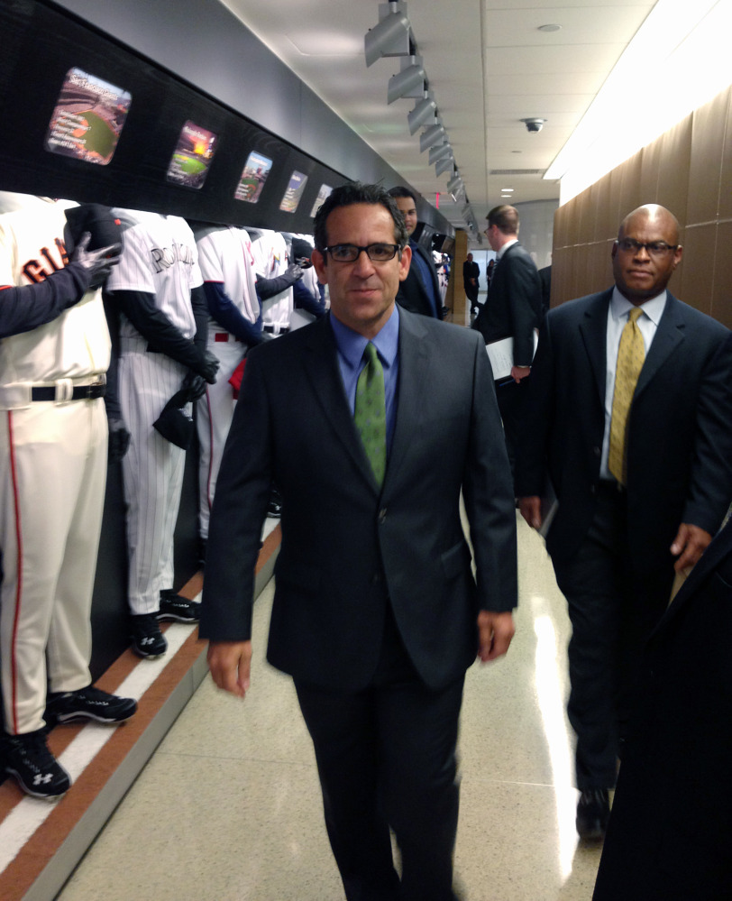 FILE - In this Sept. 30, 2013, file photo provided by Fitzpatrick Communications, Anthony Bosch is escorted by Major League Baseball security person Ric Burnham, right, at MLB headquarters in New York.