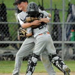 Skowhegan catcher Jimmy Reed, 25, left, celebrates with pitcher Kyle Kruse, 2, after defeating Riverside 13-2 in the 11U Cal Ripken regional tournament at Carl Wright Complex in Skowhegan on Tuesday.