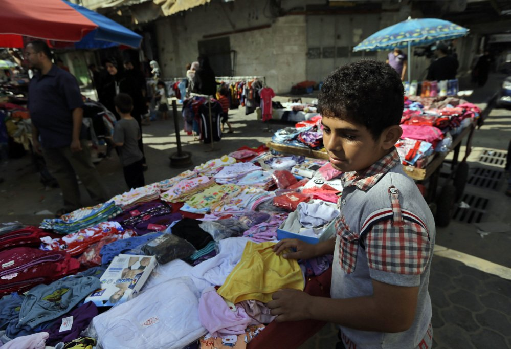 A Palestinian vendor arranges his merchandise at a market in Gaza City, northern Gaza Strip, Wednesday.
