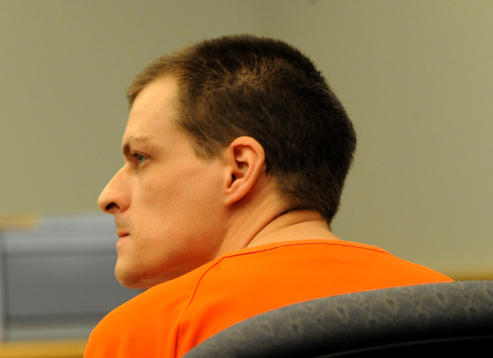 Nathaniel Kibby listens during a court hearing Wednesday in Ossipee, N.H.