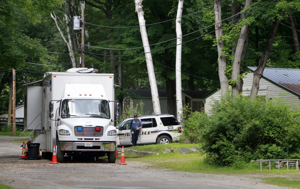 Police stand guard outside the trailer park home of Nathaniel Kibby on Wednesday in Gorham, N.H.