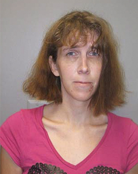 Booking photograph of suspect held in an Ohio jail who refuses to identify herself. Police say the woman may have ties to Kennebec County, and has tried to disguise her appearance and burn off her fingerprints.