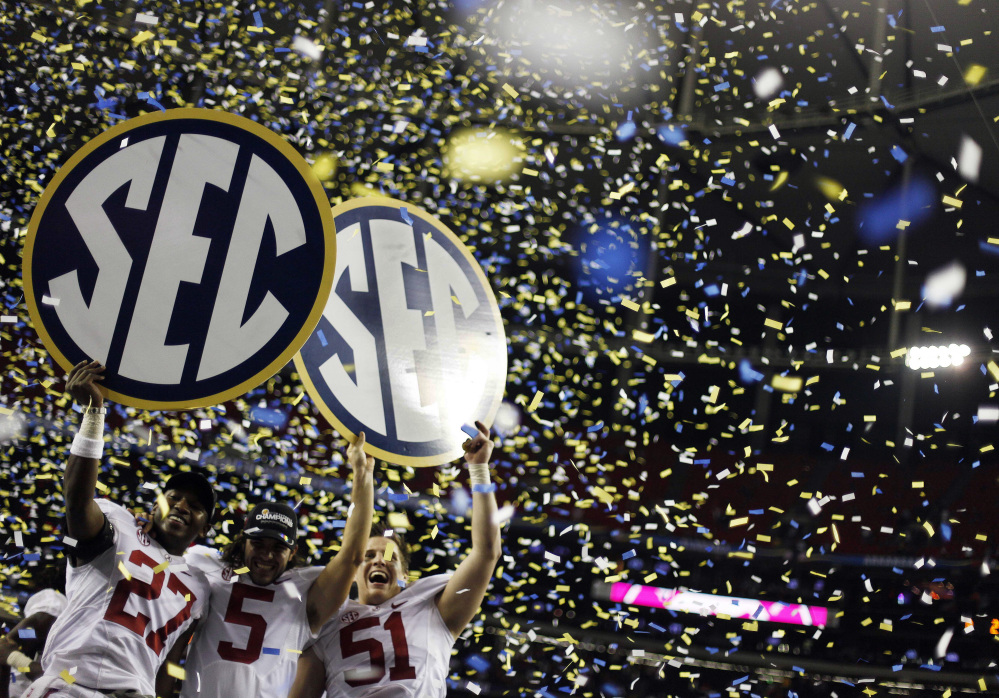Alabama players celebrate their win in the Southeastern Conference championship NCAA college football game against Georgia, in Atlanta in 2012.