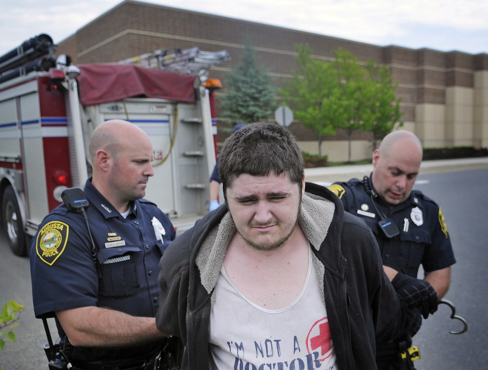 Matthew True, 20, was arrested June 24 by Augusta police Officers Curtis Gray, right, and Donald Whitten outside the Kohl's department store in Augusta.