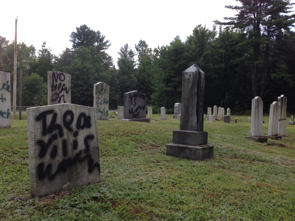 Normal:Graffiti defaces several gravestones Wednesday in Pleasant View Ridge Cemetery in China.