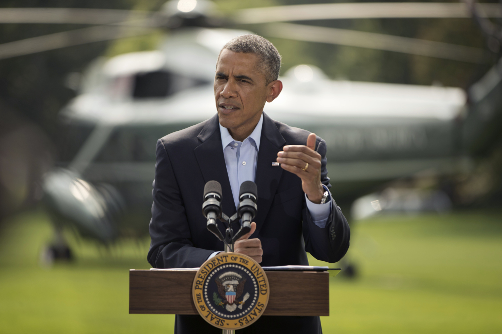 President Barack Obama speaks on the South Lawn of the White House in Washington, Saturday, about ongoing situation in Iraq before his departure on Marine One for a vacation in Martha's Vineyard.