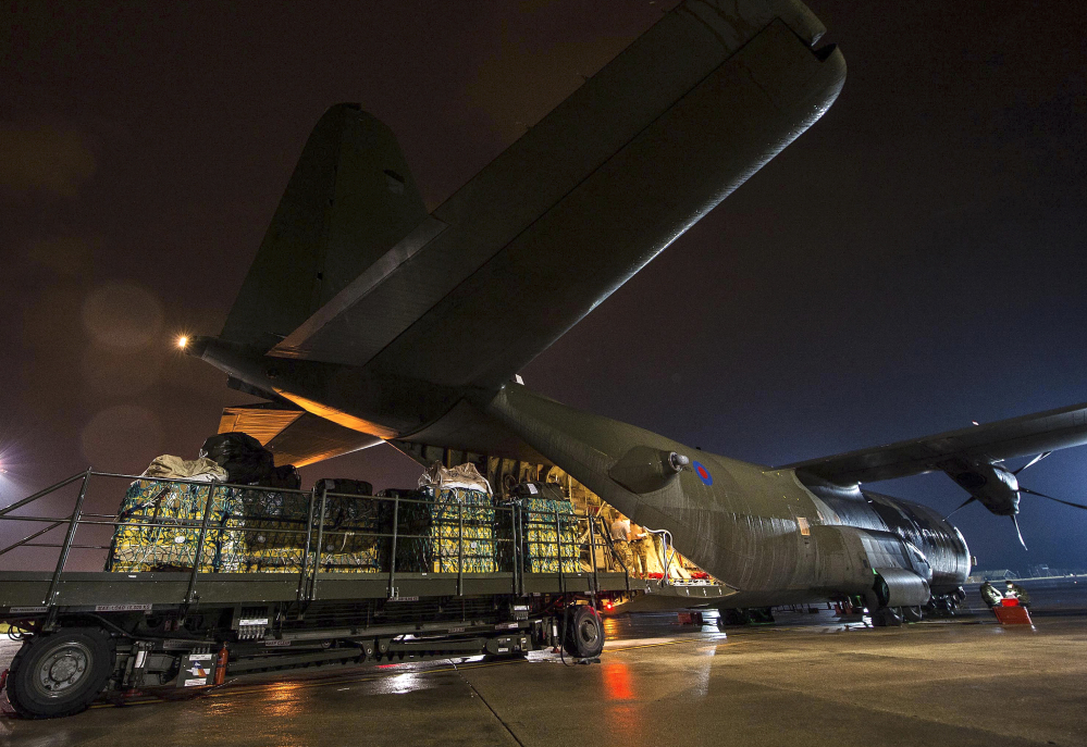 In this British Ministry of Defence image taken Friday Aug., humanitarian aid being loaded onto a RAF Hercules C130 at RAF Brize Norton, England en-route for Iraq, as the West tries to counter the threat from Islamic State (IS) extremists in the troubled country.