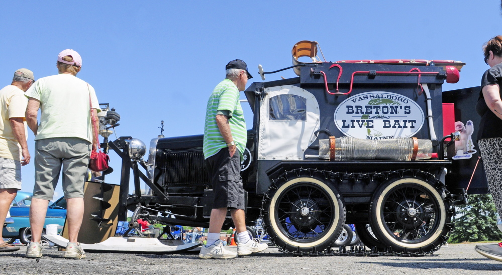 Visitors look at Richard Breton's 1930 Ford Model A snowmobile during a car show Saturday in the Augusta Civic Center parking lot. The event was a fundraiser for the Maine Children's Cancer Program.