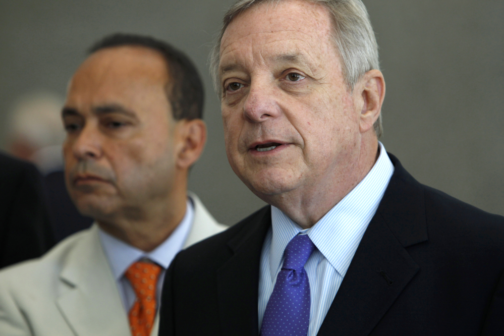 The Associated Press This Friday, June 13, 2014, file photo shows Sen. Dick Durbin, D-Ill., right, joined by Homeland Security Secretary Jeh Johnson, as he speaks during a news conference in Chicago. Islamic militants' growing influence in Iraq and Syria are a threat to Americans, lawmakers from both political parties agreed Sunday even as they sharply disagreed on what role the United States should play in crushing them.