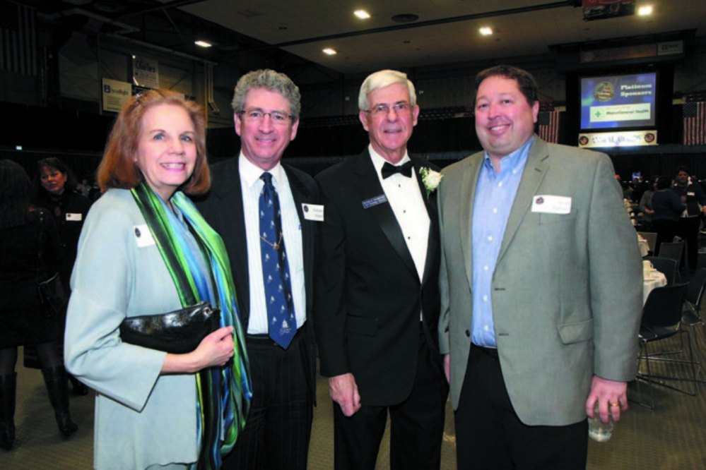 From left, Diane Doyen with husband and then Augusta Mayor William Stokes, Kennebec Valley Chamber of Commerce President Peter Thompson and Scott Upham of Cribstone Capital Managagement at the KV Chamber's annual awards banquet in January 2013.