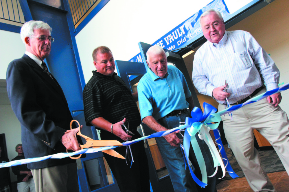 The Bank of Maine Ice Vault, at the site of the former Kennebec Ice Arena, officially opened in July 2012 in Hallowell with a ribbon cutting ceremony. From left to right is Peter Thompson of the Kennebec Valley Chamber of Commerce, Steve Prescott, Rosy Santerre, a former owner of KIA, and owner Peter Prescott.