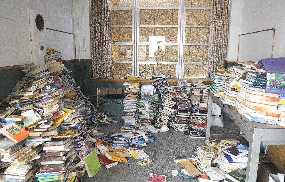 In this April file photo, textbooks were stacked up in the office of the former Hodgkins Middle School in Augusta.