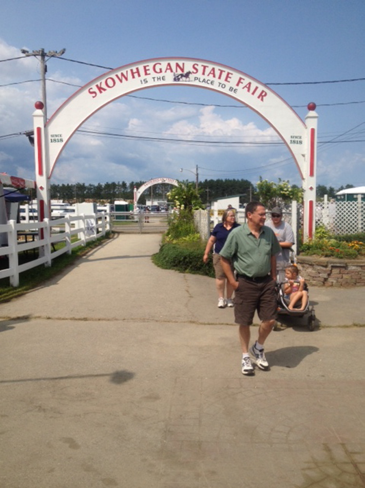 Double arches mark the entrance to the midway Sunday during the 196th annual Skowhegan State Fair.