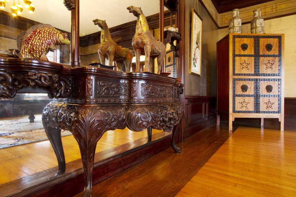 A custon built Etagere against a mirror wall is one of the features of a first floor room in the West Mansion on Portland's Western Promanade. The 13,000 square foot residence, Portland's largest, is on the market for sale at just under $ 3 million.