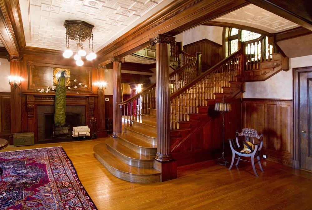 The first floor foyer of the West Mansion, like the rest of the mansion, features elaborate tiger maple woodwork.