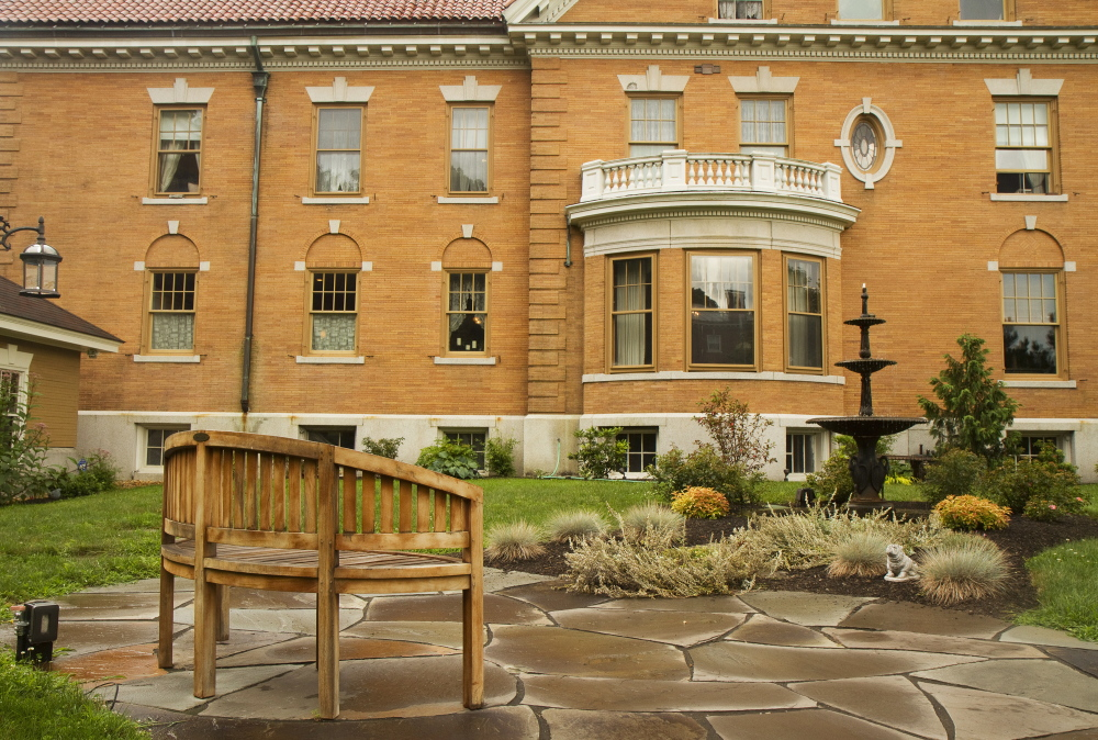 A patio overlooks a fountain on the grounds of West Mansion on Portland's Western Promanade. The 13,000 square foot residence, Portland's largest, is on the market for just under $ 3 million.
