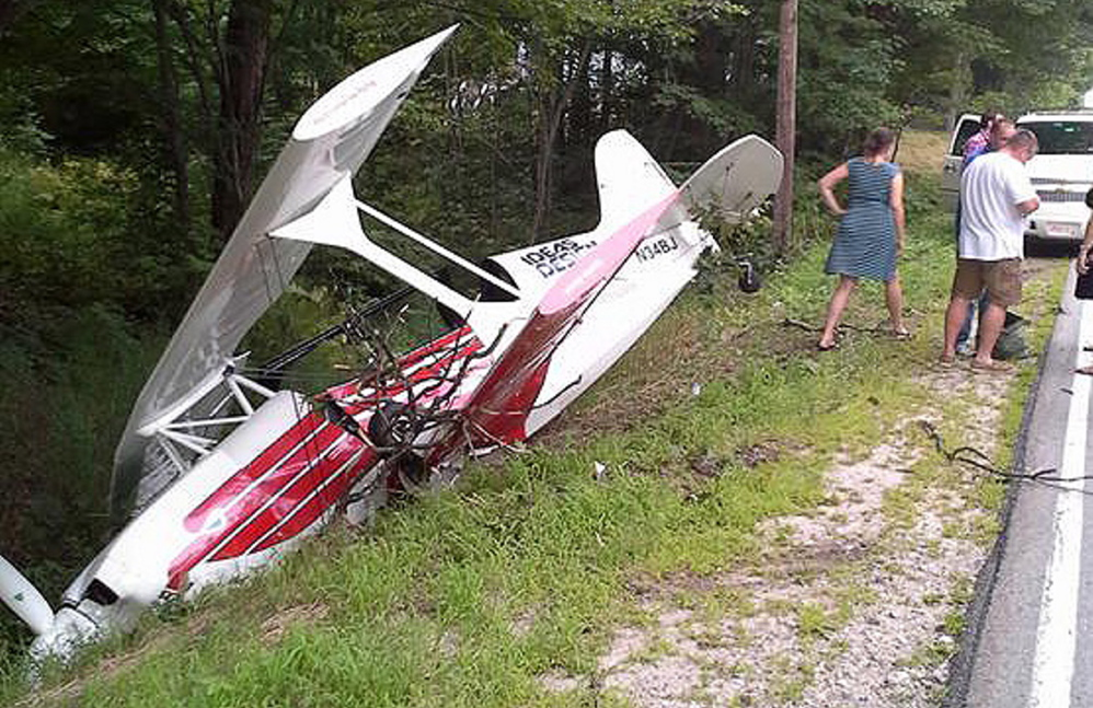 A single-engine plane rests in a ditch beside Route 35 in Standish on Sunday. The pilot suffered only minor injuries.