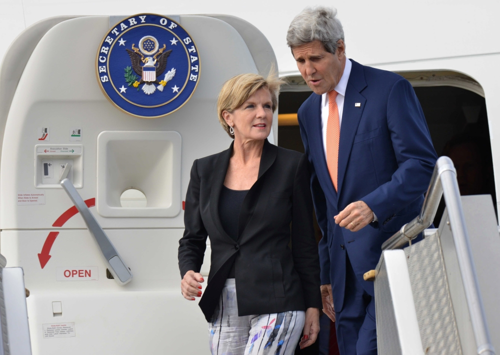 U.S. Secretary of State John Kerry, right, and Australian Minister for Foreign Affairs Julie Bishop arrive at an airport in Sydney, Monday.