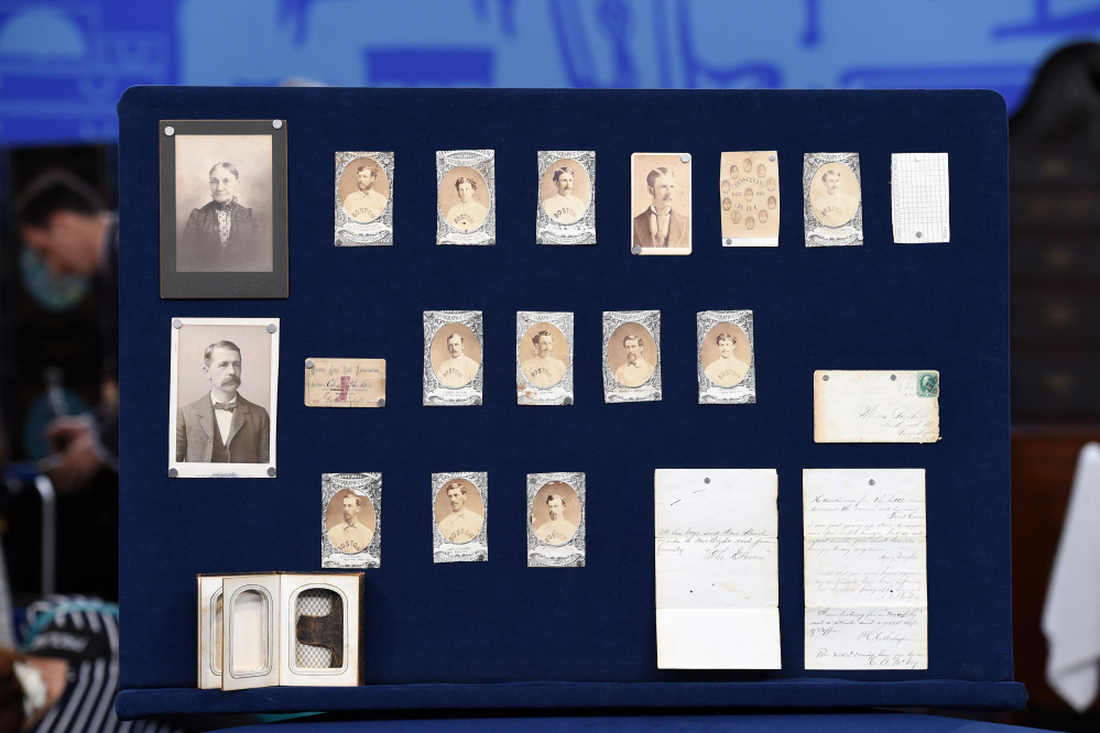 """This Aug. 9, 2014 photo released by Antiques Roadshow shows a collection of early Boston baseball memorabilia for the program """"Antiques Roadshow"""" in New York."""