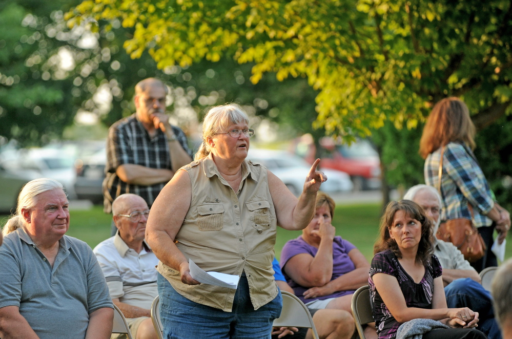 Patricia Lanning, center, speaks during a special town meeting in Benton on Monday. The town voted down a fireworks ordinance that would have restricted the use to Independence Day only.