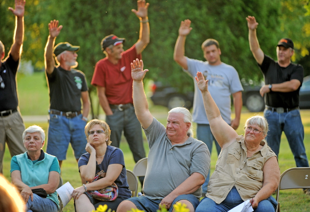 Benton residents vote down a fireworks ordinance that would have restricted the use to Independence Day only during a special town meeting at the gazebo in Benton on Monday.