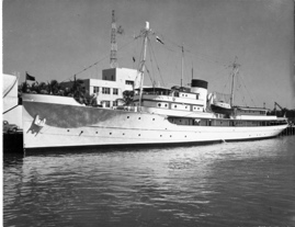 Above, the USS Williamsburg sits at a shipyard in La Spezia, Italy, where it has been stored for 20 years. At left, the yacht in better times during President Harry S. Truman's vacation in Florida.   Photos courtesy David Seal and Harry S. Truman Library & Museum